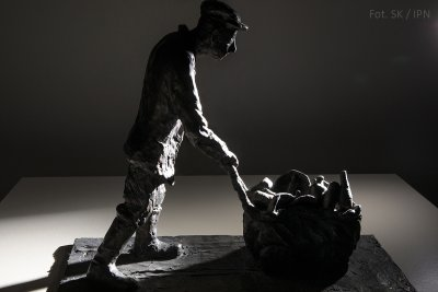 AN INMATE COLLECTING BOTTLES , BRONZE 2000